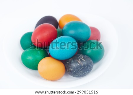 Easter colorful painted eggs on a white plate