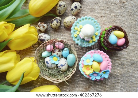 Easter composition, Easter cupcakes and yellow tulips - stock photo