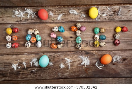 Easter composition from eggs on old wooden table - stock photo