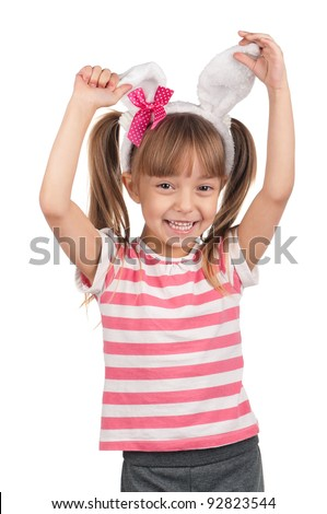 Easter concept image. Portrait of happy little girl with bunny ears over white background. - stock photo