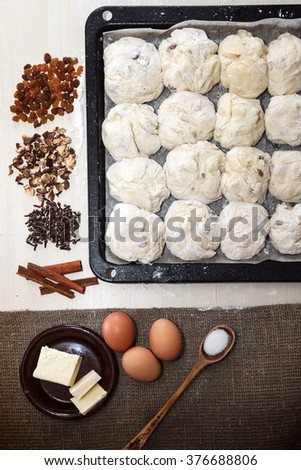 Easter concept. Ingredients for cooking easter pie. Raw dough ready for cooking on backing pan, top view - stock photo
