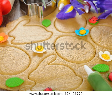Easter cookie dough on brown background