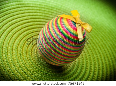Easter decoration egg  on green background. Vivid colors - stock photo