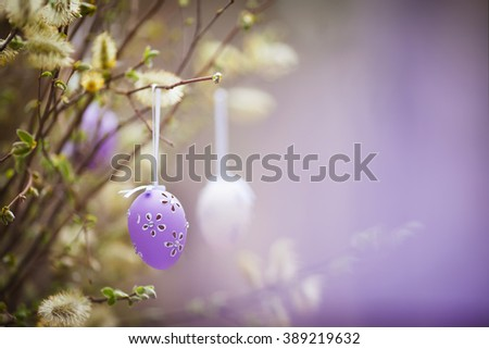 Easter decoration  in the garden. Spring bouquet of blossoming willow with easter egg. - stock photo
