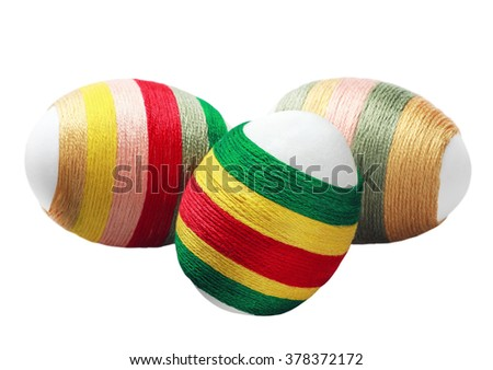 Easter decoration isolated on white background. Egg decorated thread