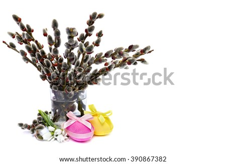 Easter decoration. Willow branch, snowdrop and Easter eggs on white background with space for text. - stock photo