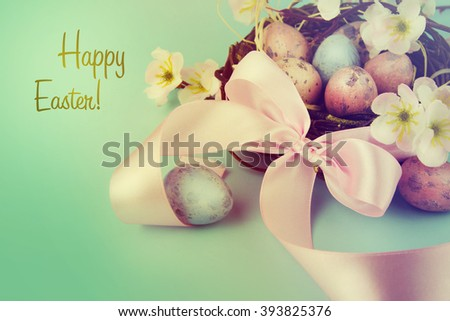 Easter decoration with eggs and feeder. - stock photo