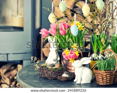 Easter decoration with flowers and eggs. Tulips, snowdrops and narcissus blooms on white background. Selective focus. Vintage style toned picture - stock photo