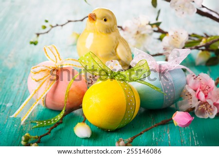Easter decoration with spring flowers,chick and eggs - stock photo