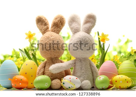 Easter decoration with sugar rabbits,eggs and flowers. - stock photo
