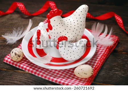 easter decoration with three white - red clay hens  on plate