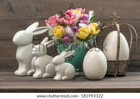 Easter decoration with tulips, eggs and rabbits. Easter bunnies. Vintage style picture - stock photo