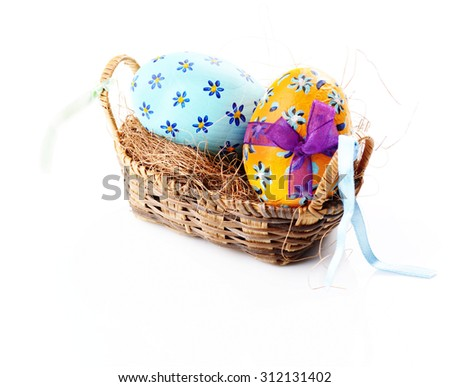 Easter decorations - easter basket with painted eggs on white - stock photo
