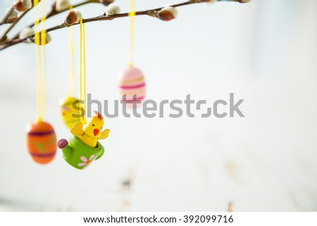 Easter decorations on pussy willow, copy space - stock photo