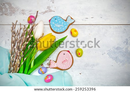 Easter decorations on wooden background - stock photo