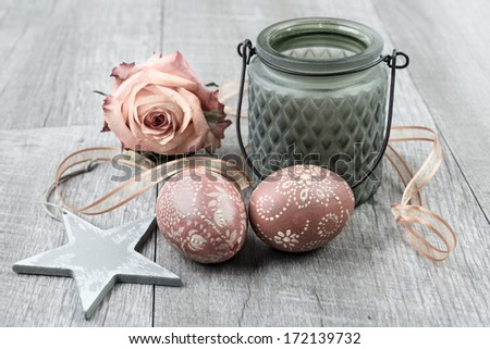 Easter decorations with easter eggs on wooden surface - stock photo