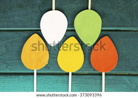 Easter egg and poster on wooden Background - stock photo