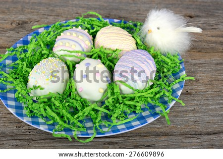 Easter egg cookies and baby chick in green grassy paper - stock photo