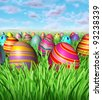 Easter egg hunt and hunting for easter eggs as a game children play after the bunny hides decorated painted eggs in the grass as a spring holiday with many painted ovals hiding in the landscape. - stock photo