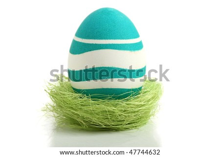 Easter egg in nest, isolated on white background