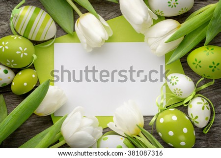Easter egg,tulips and empty card for your text. - stock photo