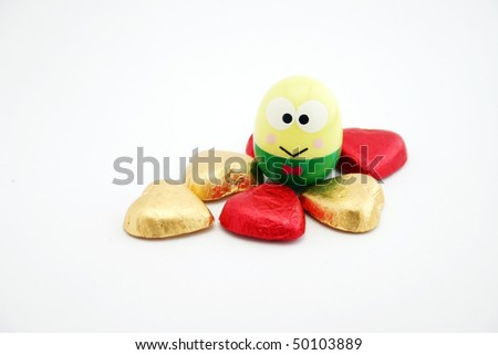 Easter egg with heart shape candy. - stock photo