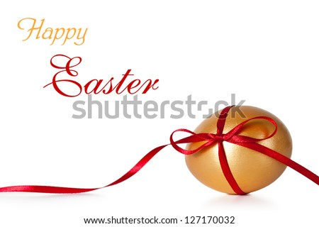 Easter egg with red ribbon on white background - stock photo