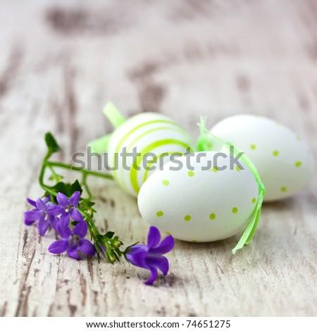 Easter eggs and bellflower - stock photo