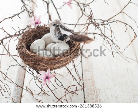 Easter eggs and bird in nest, selective focus