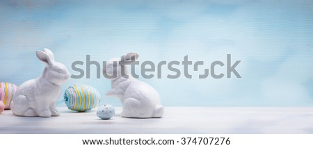Easter eggs and Easter bunny on wooden background  - stock photo