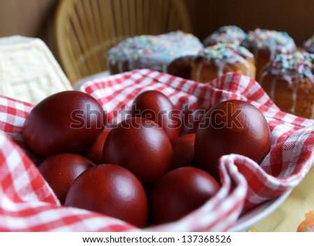 Easter eggs and Easter cakes on a table. - stock photo