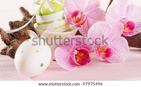 Easter eggs and orchid flowers