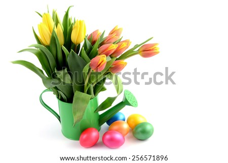 easter eggs around water can vase with Tulips