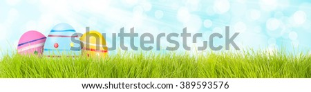 easter eggs background with grass - stock photo