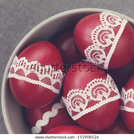 Easter eggs decorated with lace in a bowl - stock photo