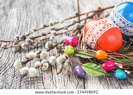 Easter eggs decorated with lace on wooden background. Toned, selective focus  - stock photo