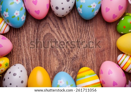 easter eggs decoration against wooden background - stock photo
