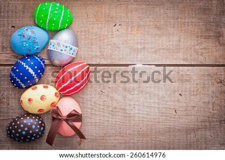 easter eggs decoration on wooden background - stock photo