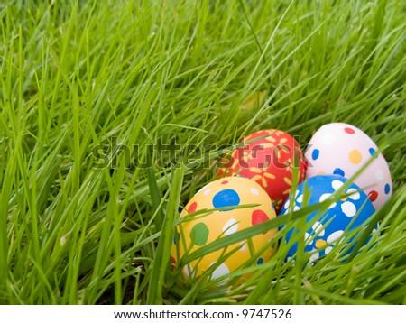 Easter eggs hidden in the grass - stock photo