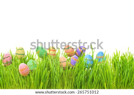 Easter eggs hiding in the grass. - stock photo