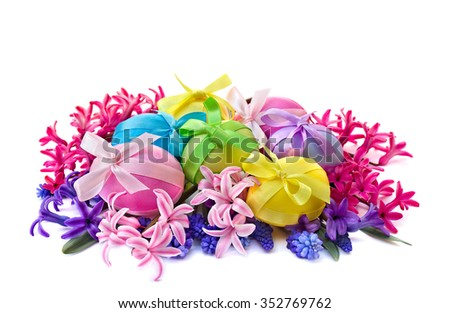 Easter eggs, hyacinth and muscari on white background - stock photo