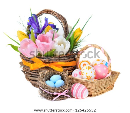 Easter eggs in a basket and spring flowers. On a white background