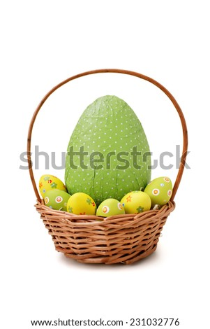 Easter eggs in a basket on white background - stock photo