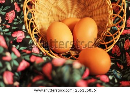easter eggs in basket on colorful flower background  - stock photo