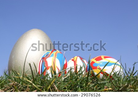Easter eggs in grass against  a bright blue sky