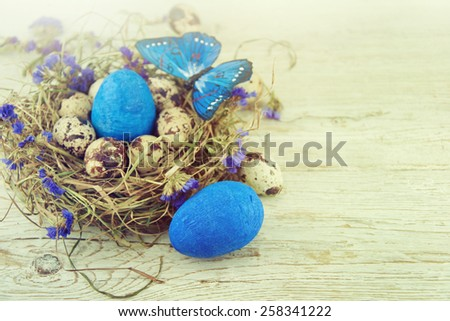 Easter eggs in nest. - stock photo