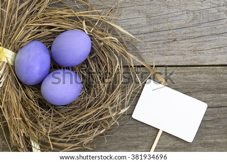 Easter eggs in nest on rustic wooden background, selective focus image, Card Happy Easter - stock photo