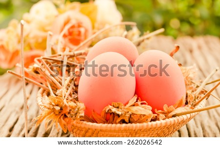 Easter eggs in the basket on natural wooden  table in style vintage retro  soft focus. - stock photo