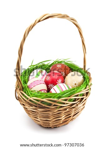 Easter eggs in the basket on white background - stock photo