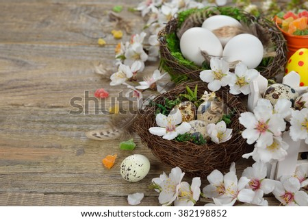 Easter eggs in the nest on wooden background - stock photo